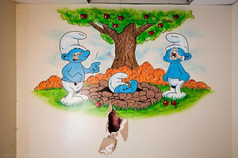 Smurfs cartoon art in an abandoned hospital -- by Joe Reifer
