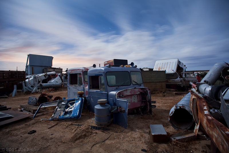 Truck cabs, metal, and clouds (Paul's Junkyard)