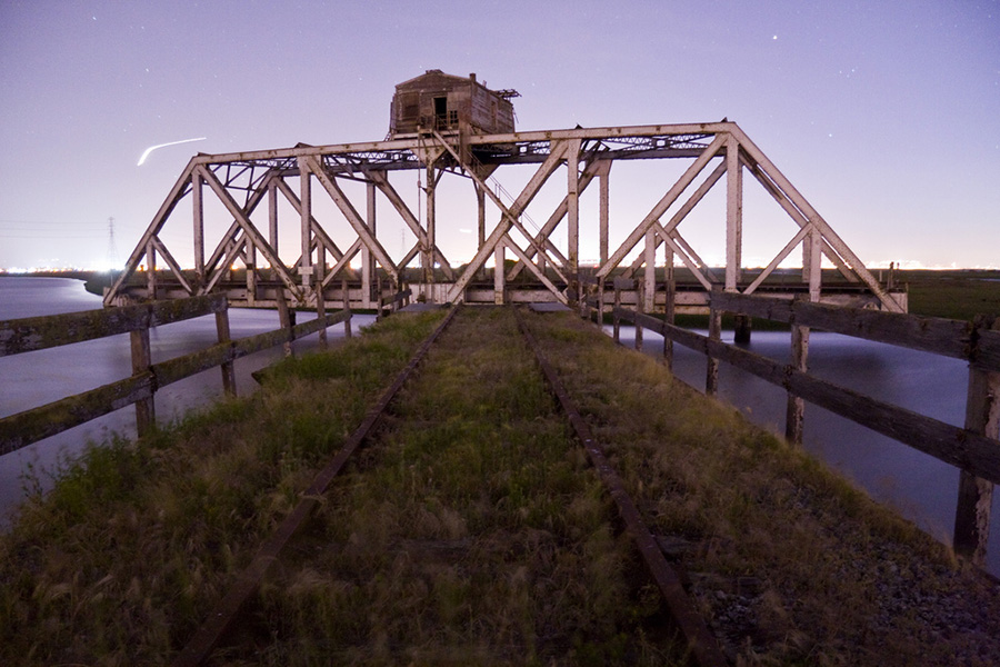 Dumbarton swing bridge with overgrown tracks -- by Sean Goebel