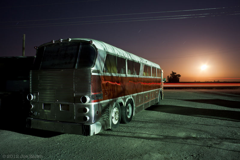Moonrise over the bus yard -- by Joe Reifer
