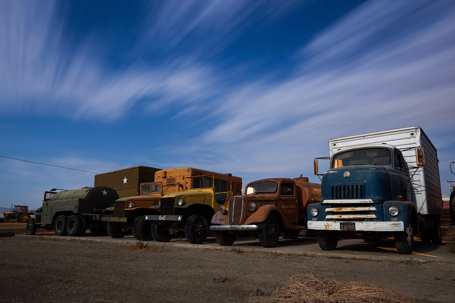 A row of trucks under the moonlight at Eagle Field - by Joe Reifer
