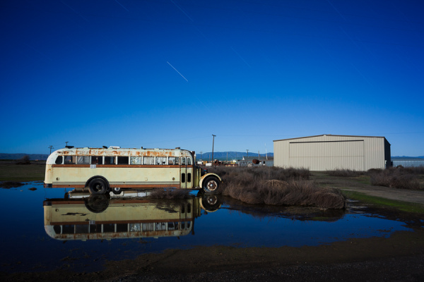 School bus reflection under the moon and stars at Eagle Field -- by Joe Reifer