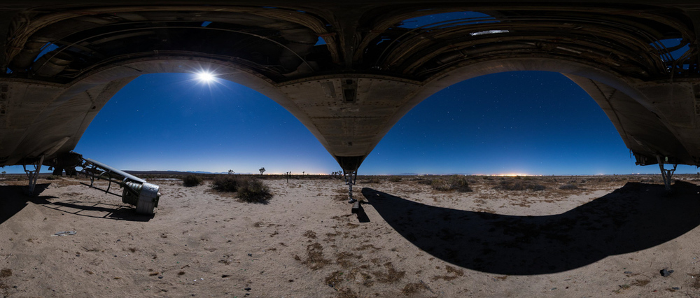 Full moon and joshua trees viewed from under a supersonic bomber in the Mojave Desert
