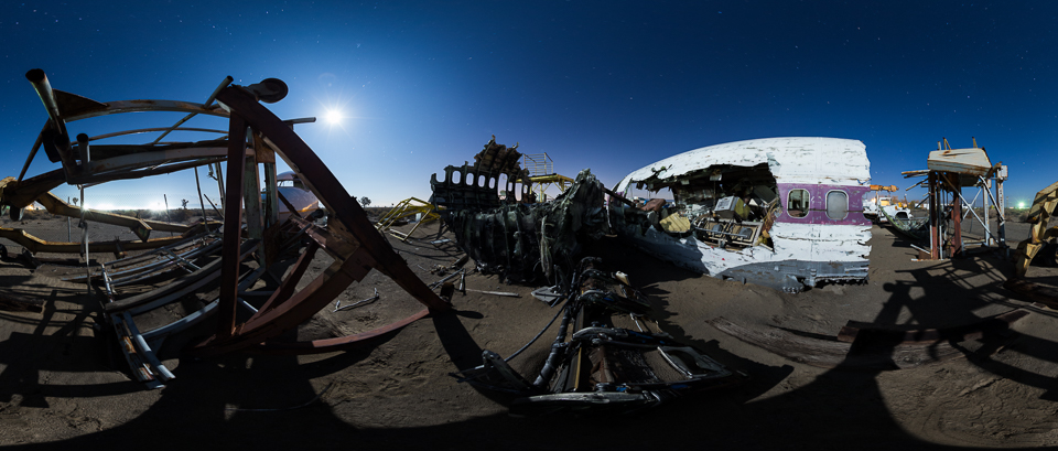 Ripped: The full moon shines over airplanes torn apart for Hollywood crash scenes.
