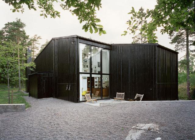 scandinavian cabin dark exterior.jpg