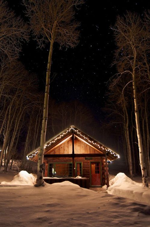 White cabin Christmas lights.jpg