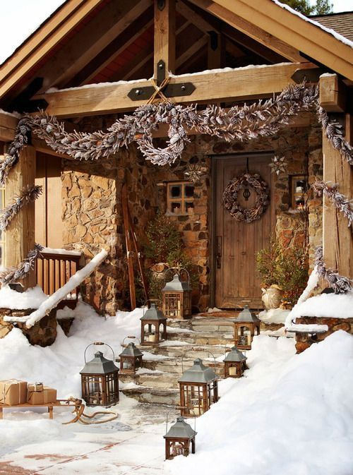 Christmas cabin lanterns lining walkway.jpg