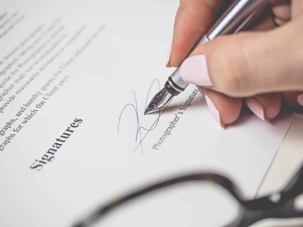 Architect Signing Document
