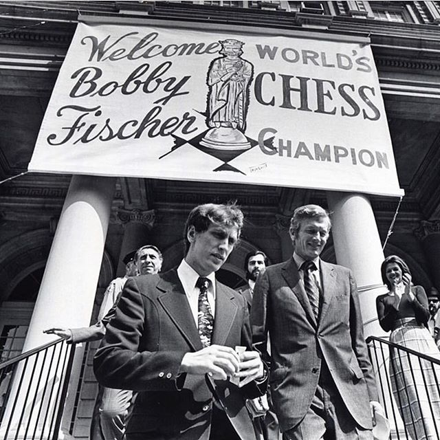 """As strategists, Bobby Fischer has always been an enigma. Still is.  #Repost @nytimes ・・・ """"It was billed as 'the Match of the Century,' and in many ways it was,"""" a @nytimes article on September 2, 1972 declared. """"Bobby Fischer, who for years has been saying he is the greatest, proved it today by becoming the chess champion of the world, the first American ever to hold the title."""" The 29-year-old from Brooklyn won the title and the $156,000 victor's share of the $250,000 purse when his opponent, Boris Spassky of the Soviet Union, didn't show up for the game and instead called the referee to resign. The match in Reykjavic, Iceland, lasted nearly 2 months. According to @nytimes, it was """"a battle for chess supremacy that had its moments of glory and its moments of slapstick comedy."""" Ultimately, though, @nytimes wrote: """"Fischer proved to be the better player. The gentlemanly Spassky was the nice guy who finished last."""" The @nytimes staff photographer Neal Boenzi took this photo of Bobby Fischer, left, being escorted from City Hall by John V. Lindsay, mayor of New York City at the time, after a reception in the chess champion's honor. #tbt #bobbyfischer #chessmen #chess"""
