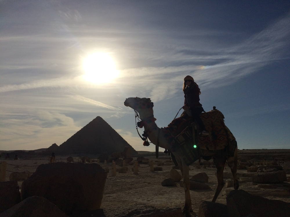 Atop a camel at the Great Pyramids of Giza in January 2015.