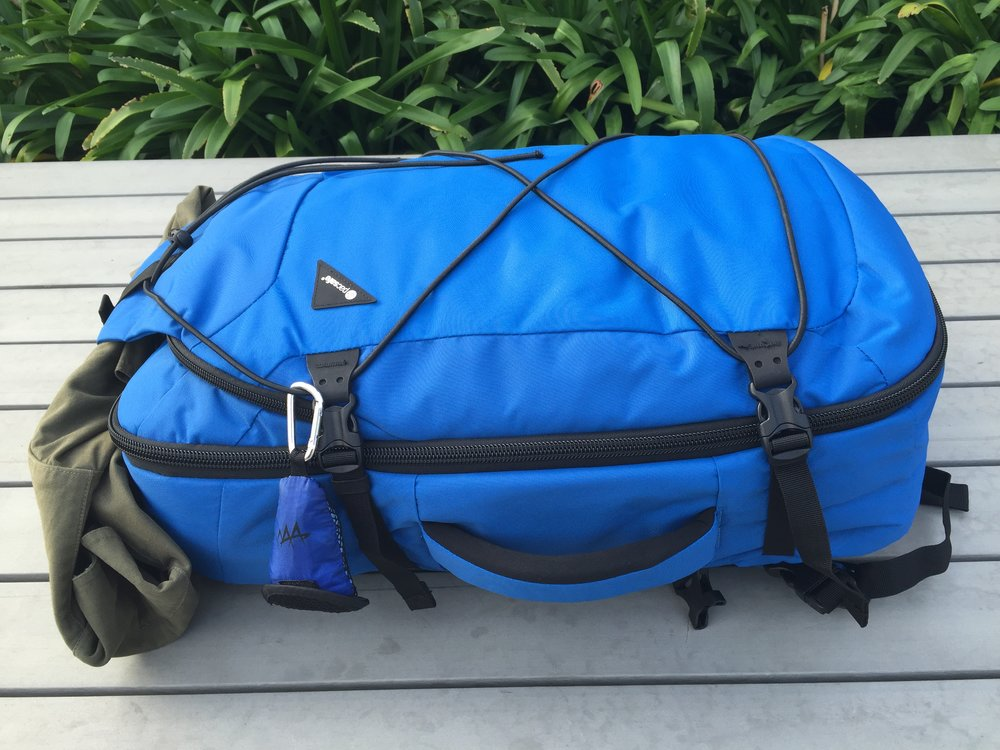 The Pacsafe Venturesafe 45L 45EXP anti-theft travel pack is fitted with  tensioning straps to 13a19db5fcf61