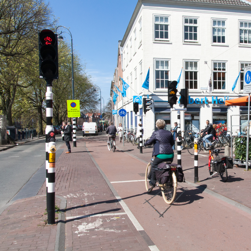 These traffic lights for cyclists turning left and going straight are at most busy intersections where cyclists and pedestrians interact.