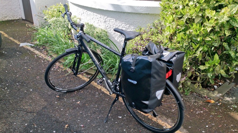 "Giant Escape 3 rented in  Dublin  and never ridden before! I added my own clipless pedals and panniers....and the ""engine"" of course!"