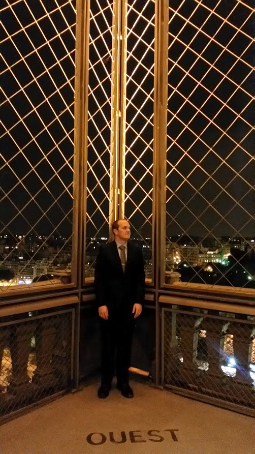 Brian looking 007 on the Eiffel Tower