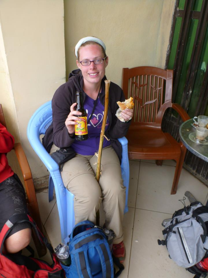 Erica recovering with beer and snacks after a day of hiking in Ethiopia with a bad ankle.