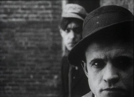 Elmer Booth in  The Musketeers of Pig Alley , 1912