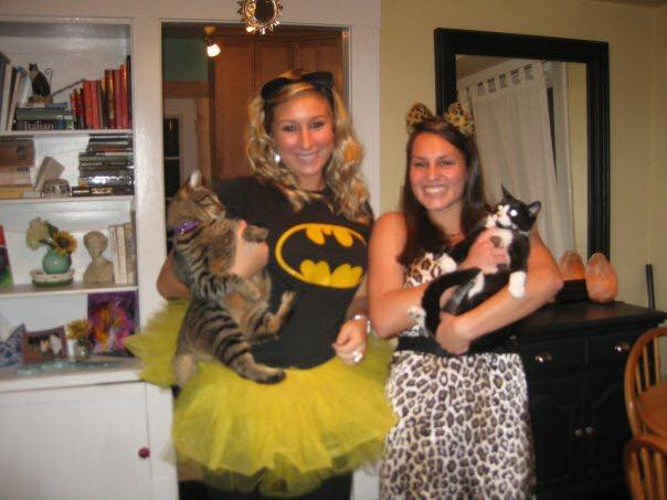 Sierra & Alex in their college house dressed as the cats they are holding - Batman & Swiper. #ballers #rockchalk