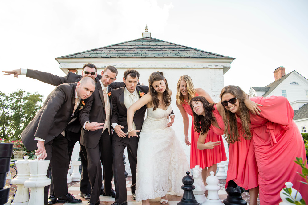 "The life size chess board made an epic bridal party shot! One of my faves. I told them to act ""gangsta"". hahaha"