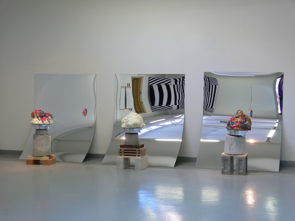 Over and Over and Over (Installation View) (2011), sculptures on rotating stands made from expandable foam, polymer clay, varnish, concrete, bricks wood and acrylic mirror,various dimensions