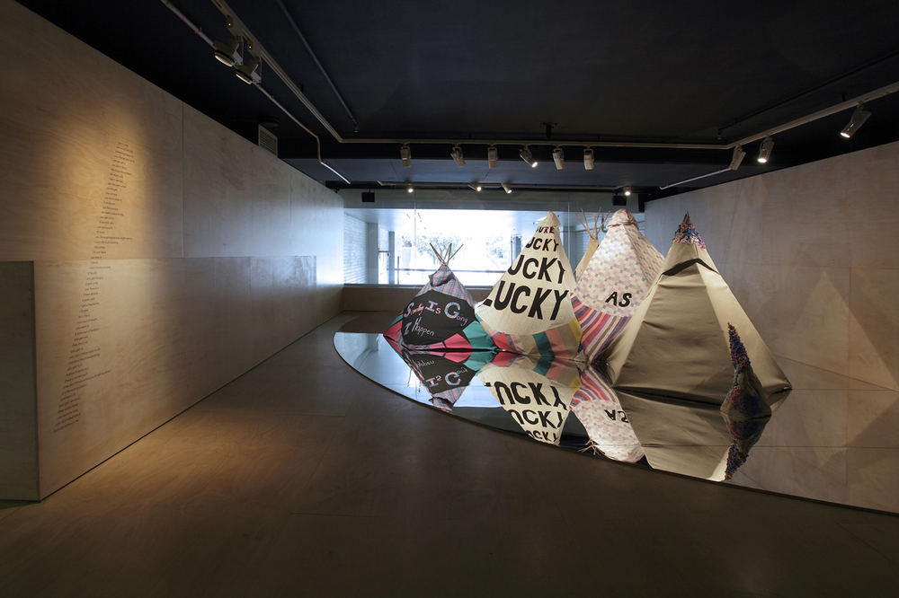 Just In Case (2010), cotton fabric, appliqué, dowel, fabric paint, linen and puff paint on mirrored floor, 17 x 12 x 6 ft