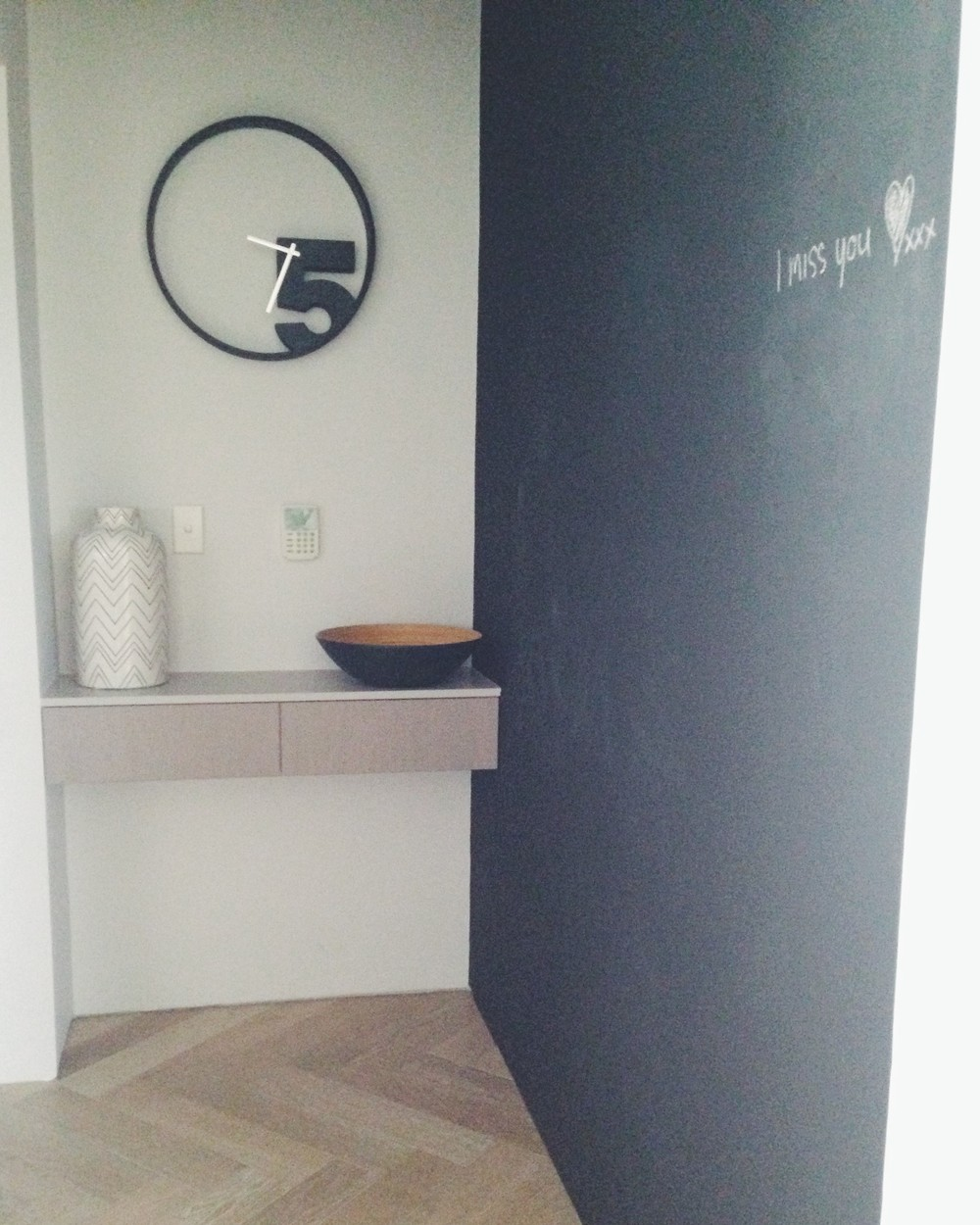 The entrance hall is painted with chalkboard paint. Perfect for notes from partner Adam!