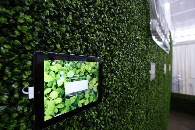 Wall mounted iPads featuring an interactive product gallery and a sign-up form for our giveaway