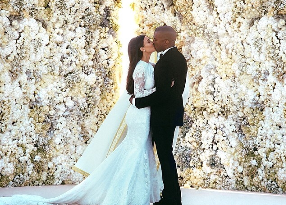 The 20 foot flower wall created for Kim Kardashian + Kanye West's wedding cost a reported $136,000