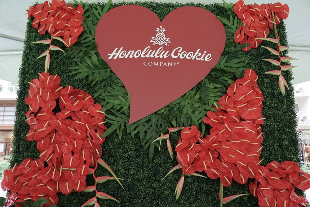 Tropical floral wall backdrop for the Honolulu Cookie Company's valentine's event.