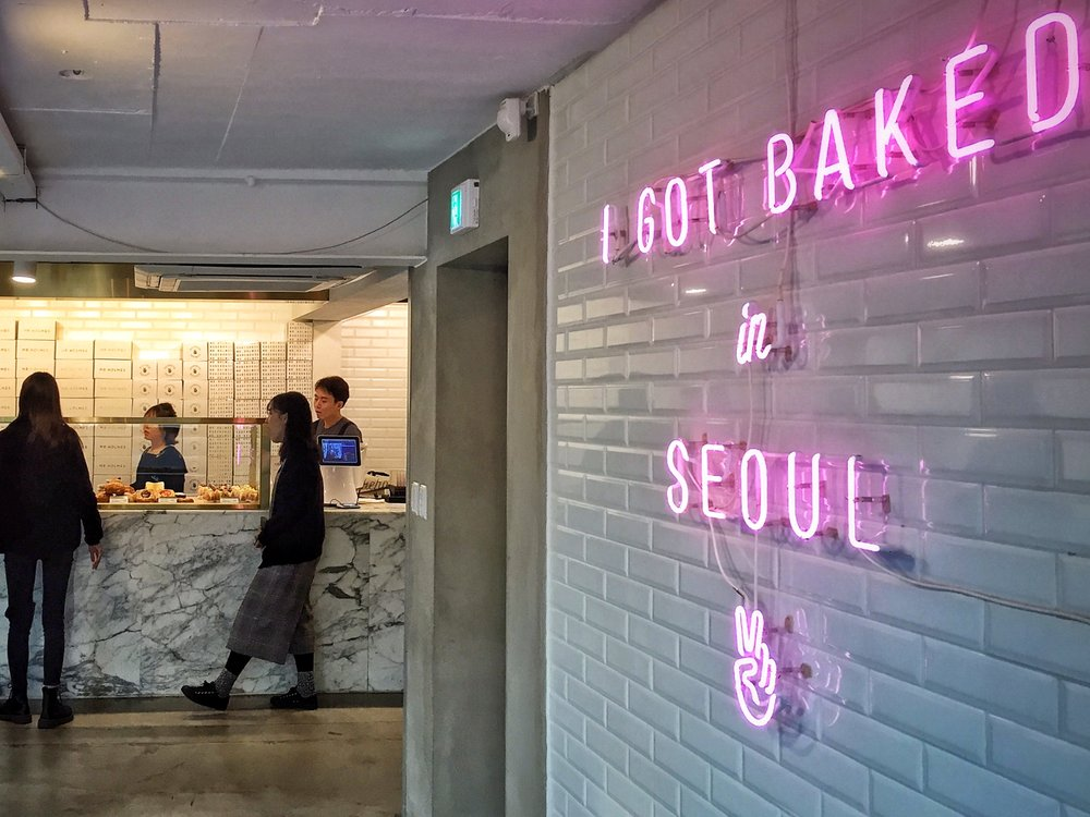 The insta-worthy neon sign provides a sweet modern touch against the classic carrara marble and subway tile.
