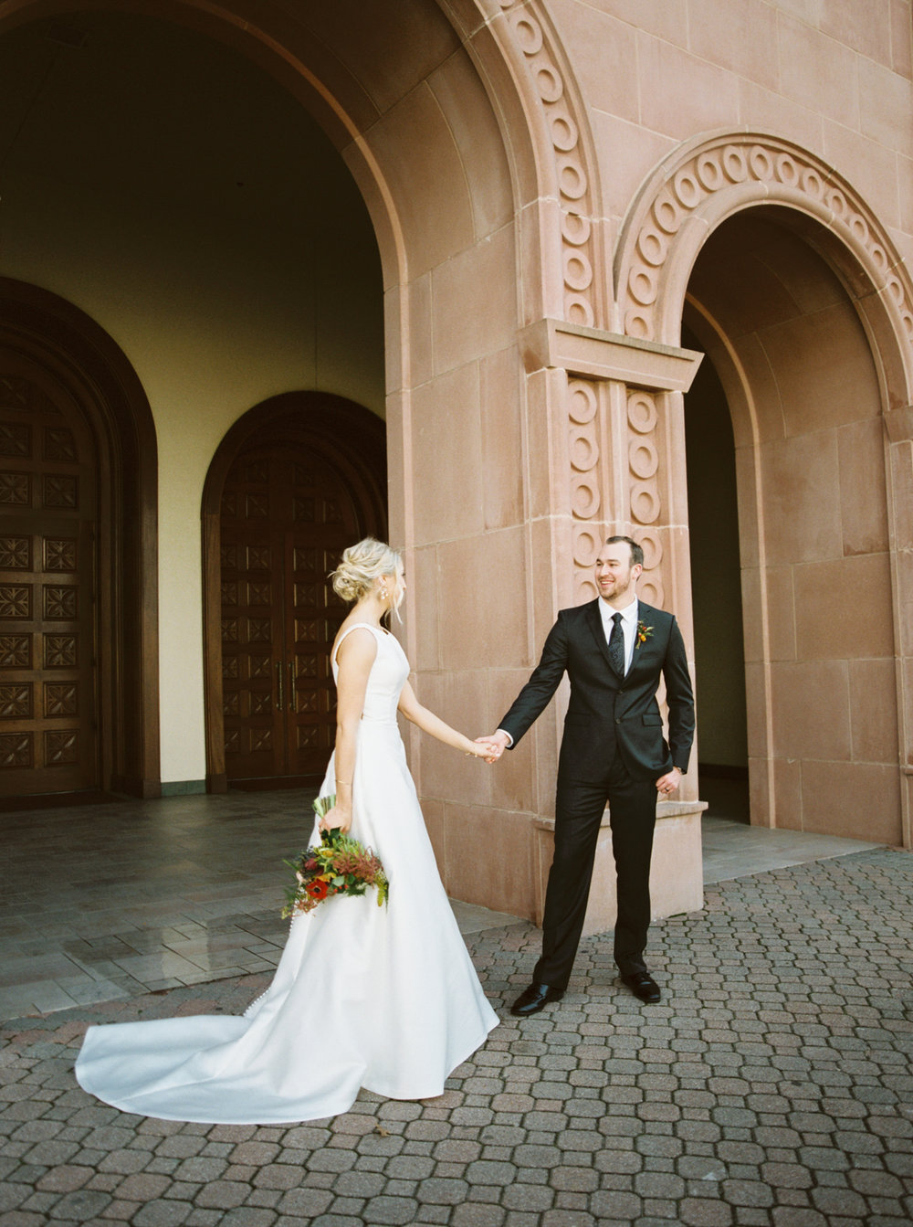 Traditional Catholic ceremony with modern warehouse reception -