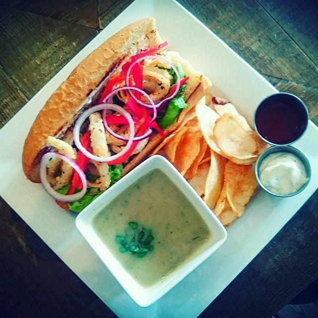 Have you ever had calamari po' boy? Come down for lunch and give it a try. It comes with soup and housemade potato chips. #lunchfeature #lunchyyc #Merchants #mardaloopyyc #welovecalamari #sandwichandsoupcombo #eatdrinkplay