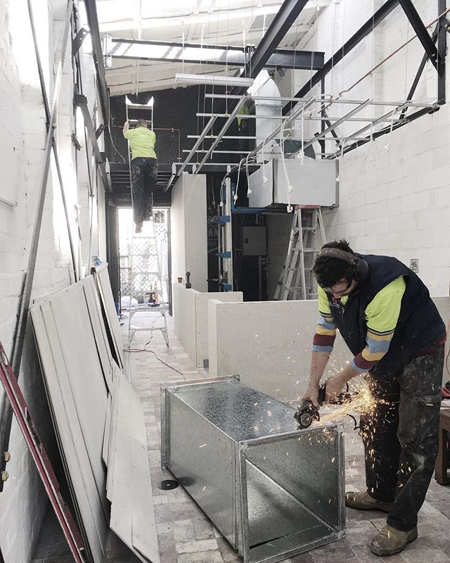The obligatory hood installation shot.... A restaurant isn't a restaurant until it has a hood, right? #ricericebaby . . . . . . #interior #design #interiordesign #construction #restaurant #site #markco #thericepantry #exhaust #galvanised #steel #sparks