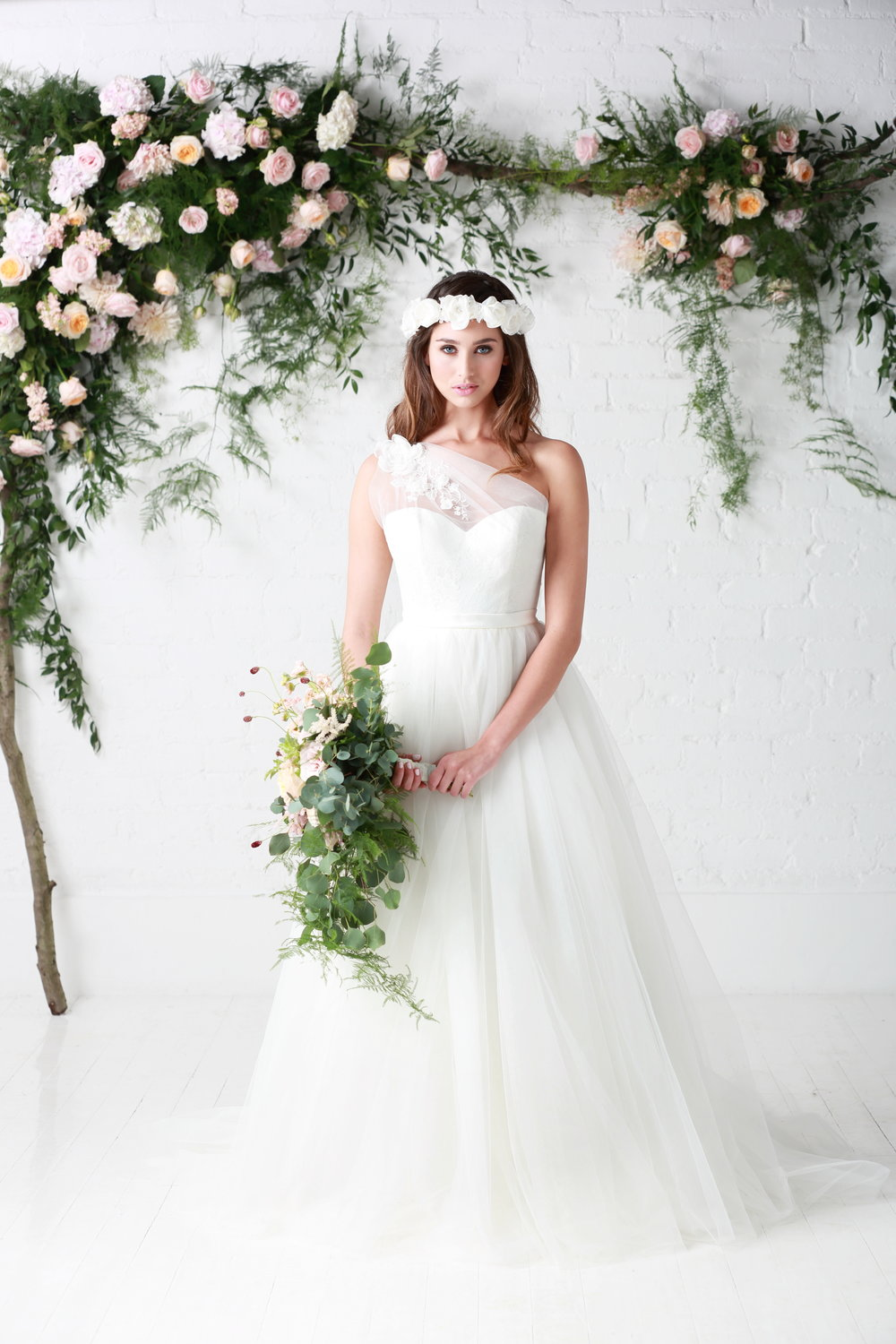 Charlotte Balbier 'Rosemary'   Beautiful Tulle Ballgown with elegant one shoulder and floral embellishment detail.  Bridal size 14  Was - £1650 Now - £825