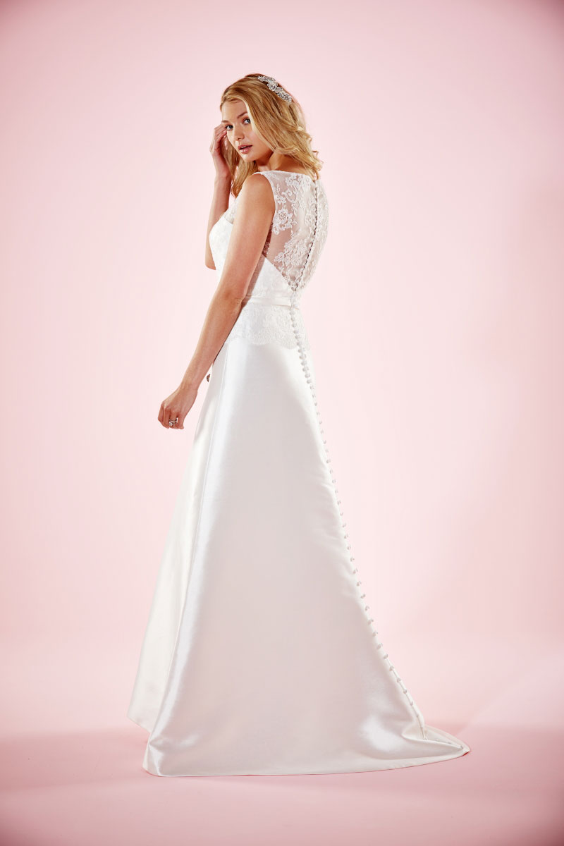 Charlotte Balbier 'Lizzie'   Elegant Mikado silk A line gown with Illusion lace back and full length button detail.  Bridal size 14  Was - £1185 Now - £595