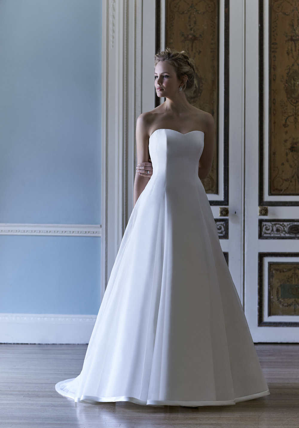 Sassi Holford 'Tatiana'   A classic Sassi Holford strapless A line gown with organza overlay.  Bridal size 16  Was - £2395  Now - £1000