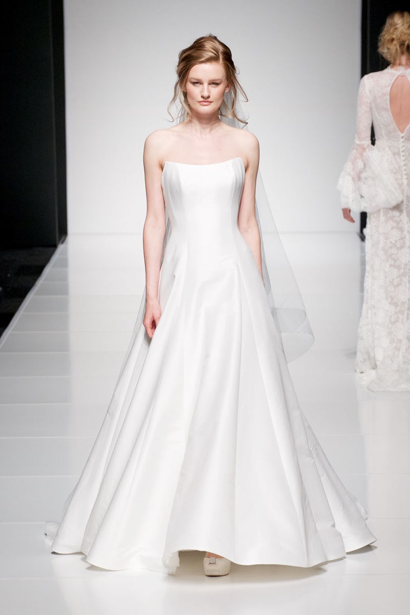 Sassi Holford 'Autumn'   Another classic Sassi style, perfect Princess gown in Italian Cotton Baby Mikado.  Bridal size 16  Was - £1995  Now - £990