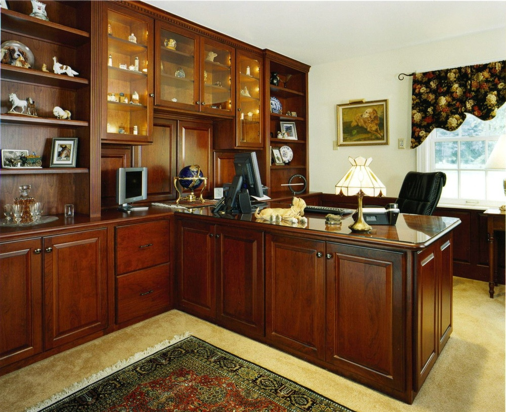 Remodeled office space with light colored walls and dark walnut finished desk and shelving for a contrasted look