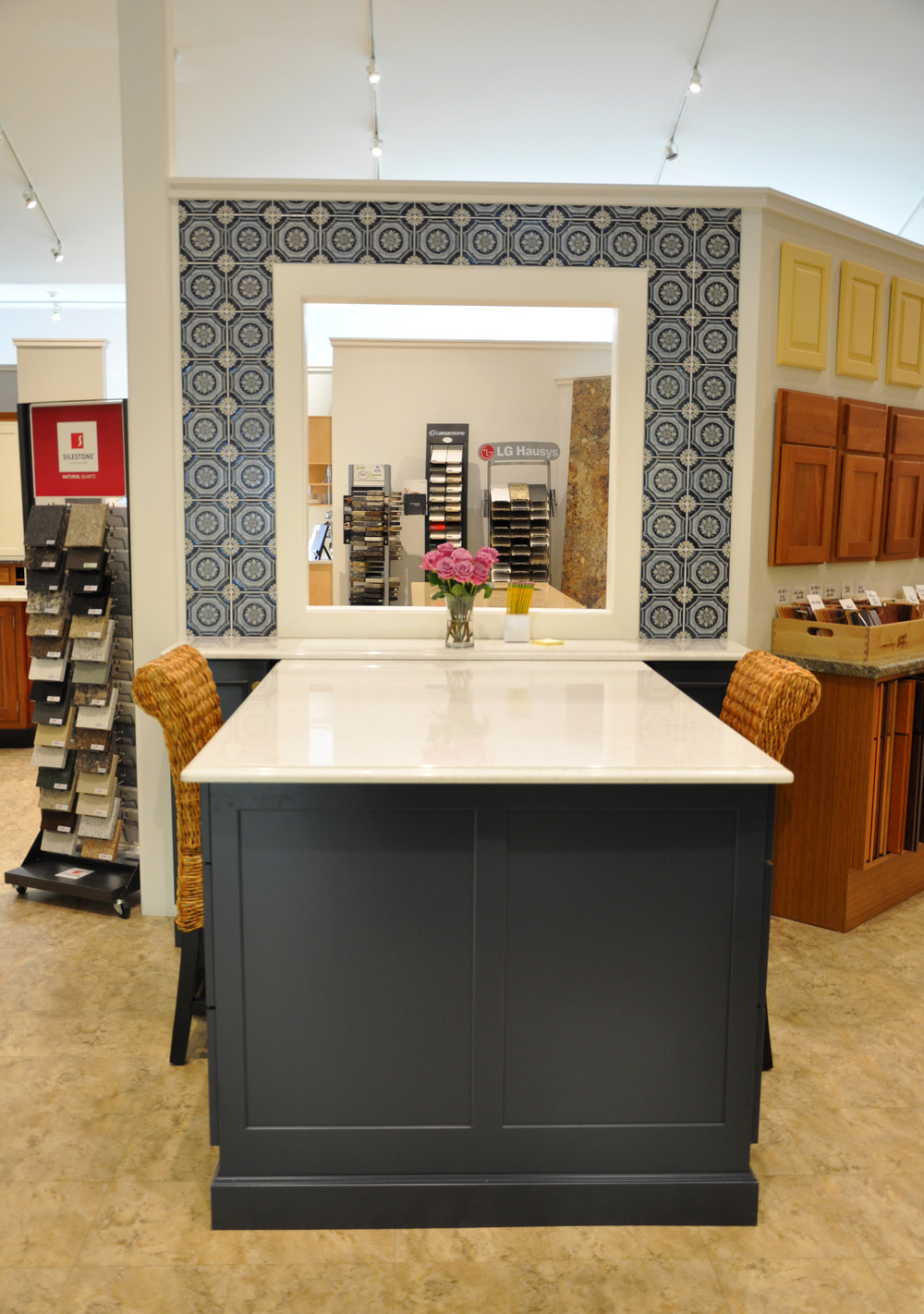Vantage by Kraftmaid Cabinetry / Lincoln Maple Door Style  / Midnight Painted Finish / Zodiaq Coarse Carrar Engineered Stone Tops / Fresca Andorra 6x6 Tile / Berenson Hardware Domestic Bliss Collection in Modern Bronze Finish / Stool from Pier 1 Imports