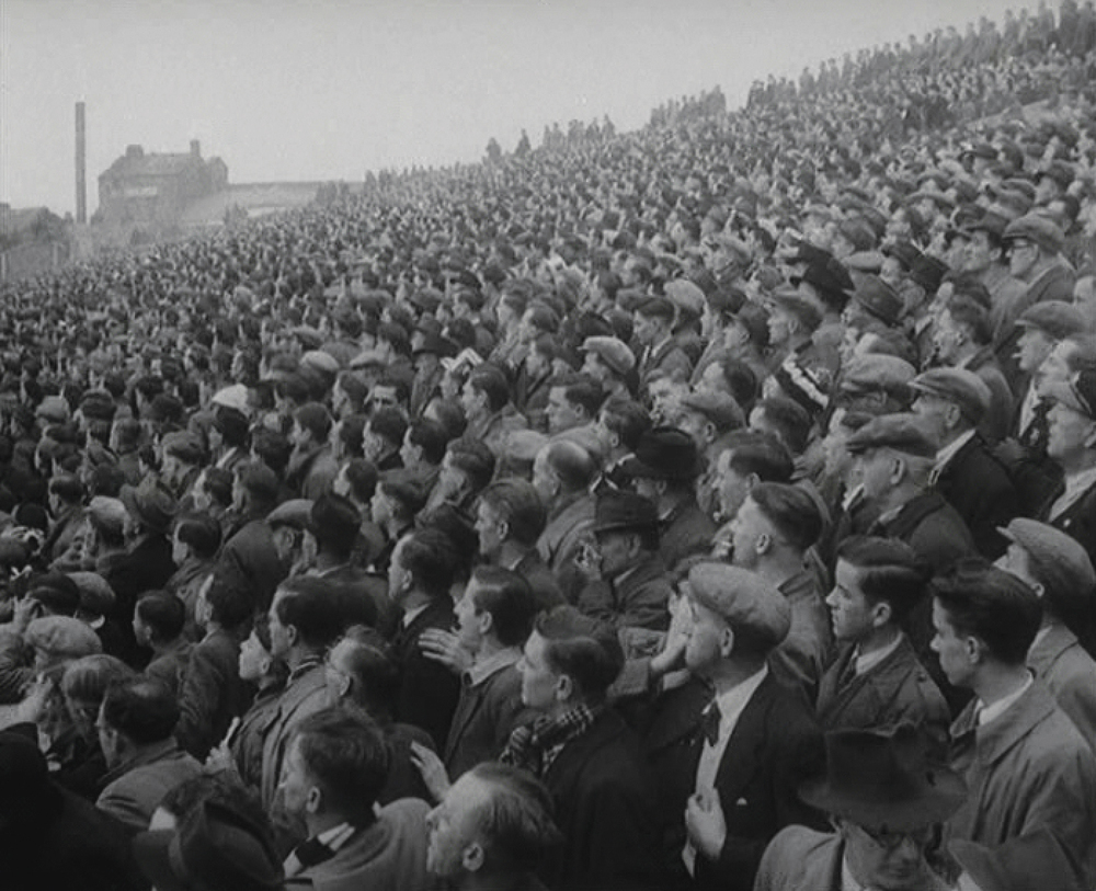 Suited fans watch Swansea vs NorthBank - circa 1950s