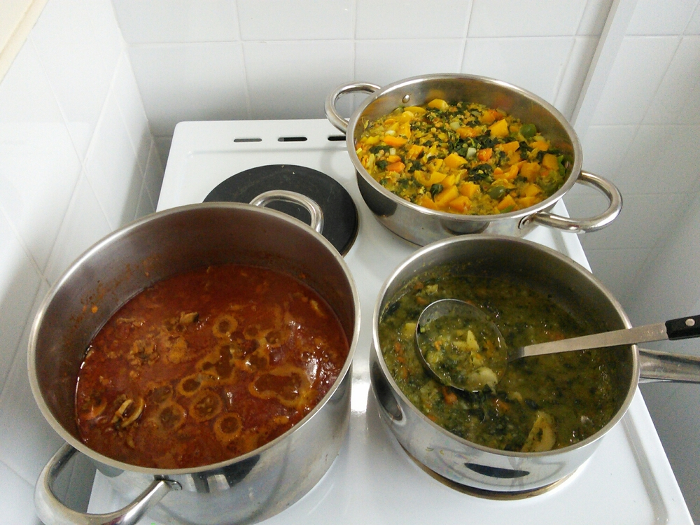 Bolognaise still bubbling, the remains of the veggie soup after lunch, and the butternut squash, spinach and lentil dahl at the back.