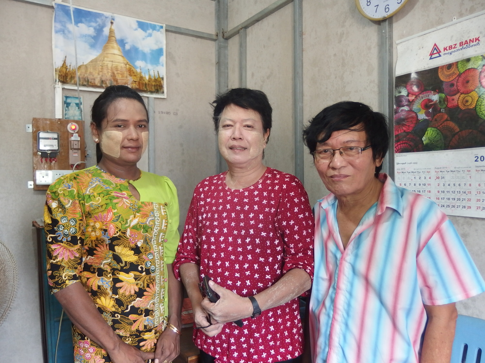 The senior staff inside the vocational centre's office, from right: Dr Myint Maw, trainer Ko Zaw, and training assistant Ma Mya Aye