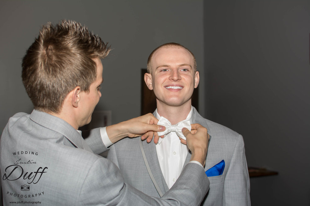 Fountains Golf Course Wedding - Royal Oak Photographer – Deanna & Shane Best man helping the groom with his tie.