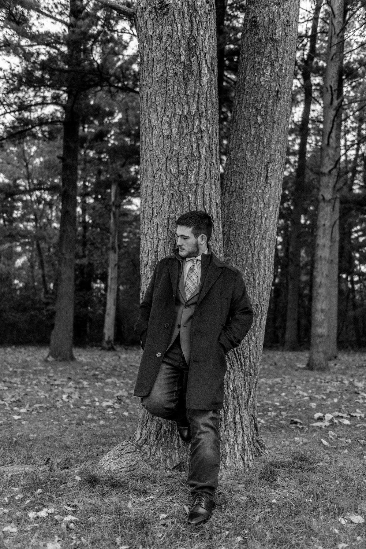 Senior Portrait, standing againts a tree