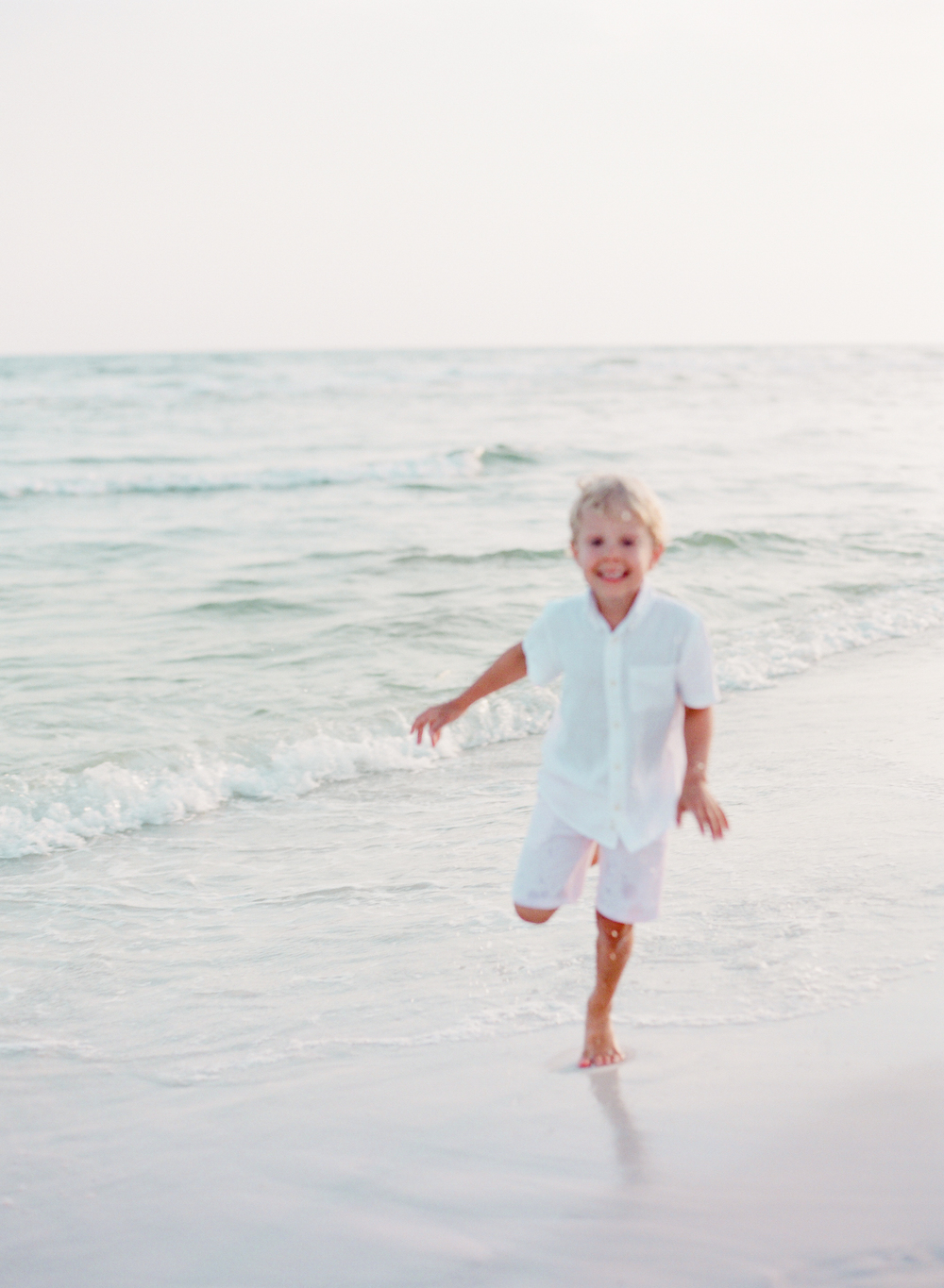 Boy running in the waves | Kaylie B. Poplin Photography | Watercolor, Florida Film Family & Wedding Photographer