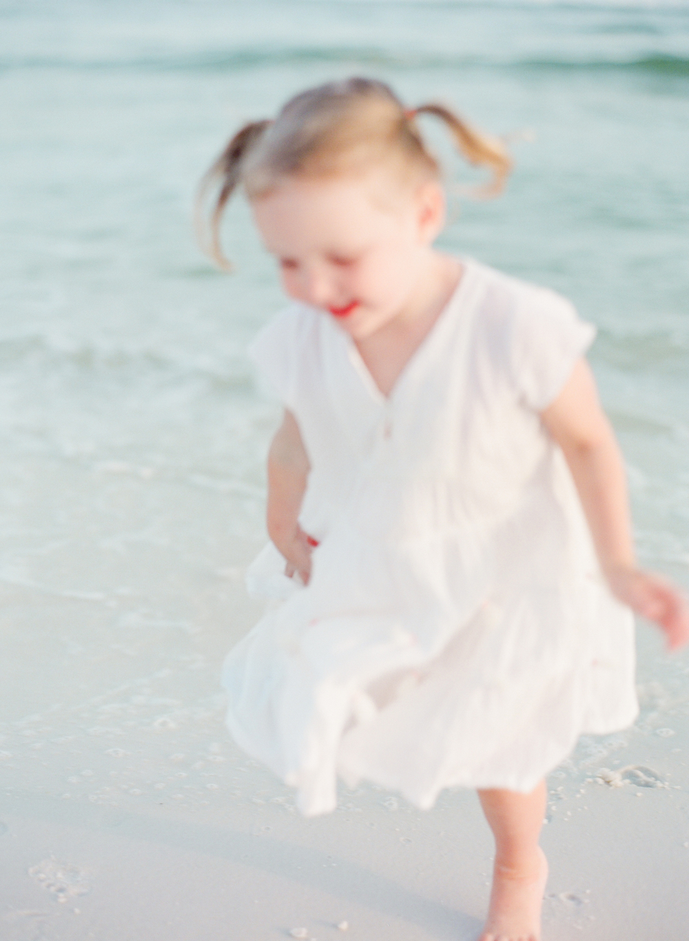 Little girl playing in the waves | Kaylie B. Poplin Photography | Watercolor, Florida Portrait & Wedding Photographer