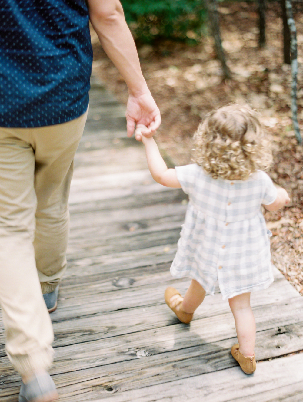 Holding daddys hand | Kaylie B. Poplin Photography | Fine Art Film Photographer | Rosemary Beach, Florida
