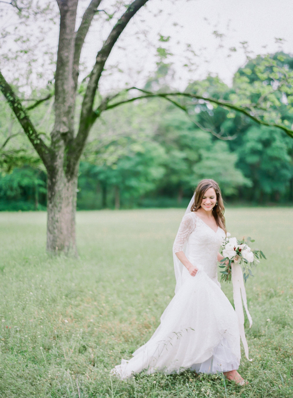 Bride Walking Through A Field | Fine Art Crestview Florida Wedding | Jennifer Blair Photography