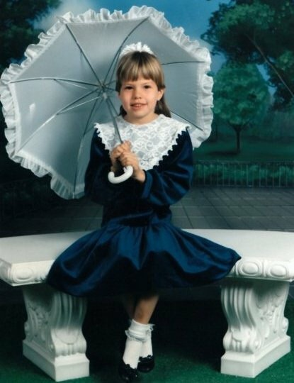 As if the matching frilly umbrella, socks & fake scenery weren't bad enough...