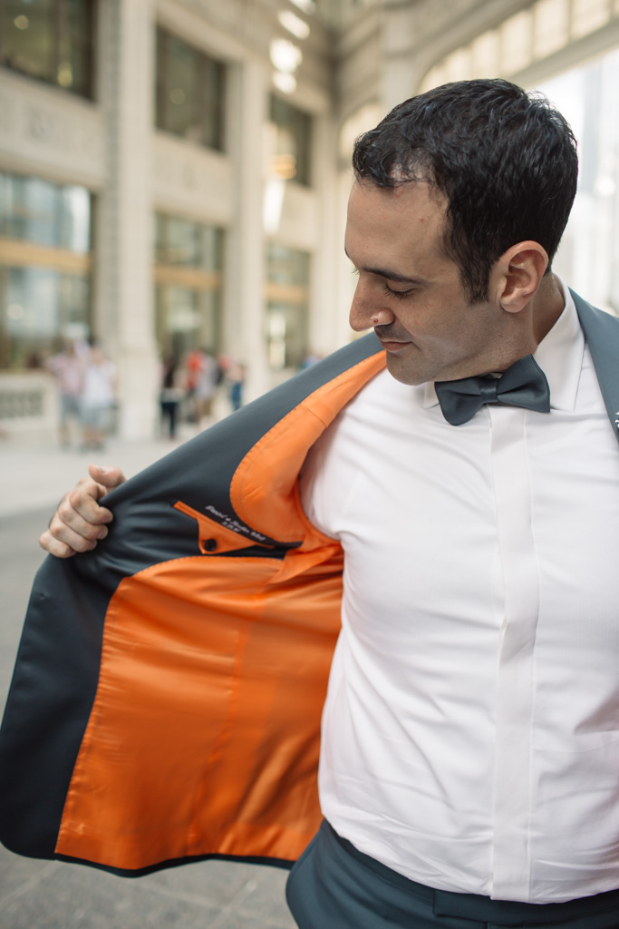Dan chose custom mensware from  Nicholas Joseph  with an orange lining to bring a hint of his favorite color to the wedding day. He had their wedding date embroidered close to his heart as a surprise for Jordan.