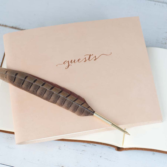 This beautiful leather album from Etsy shop, Claire Magnolia, adds texture, depth and warmth too any welcome table. Plus the binding is is a modern take on a traditional leather album. Bonus cool points for a feather quill for your quests to use!